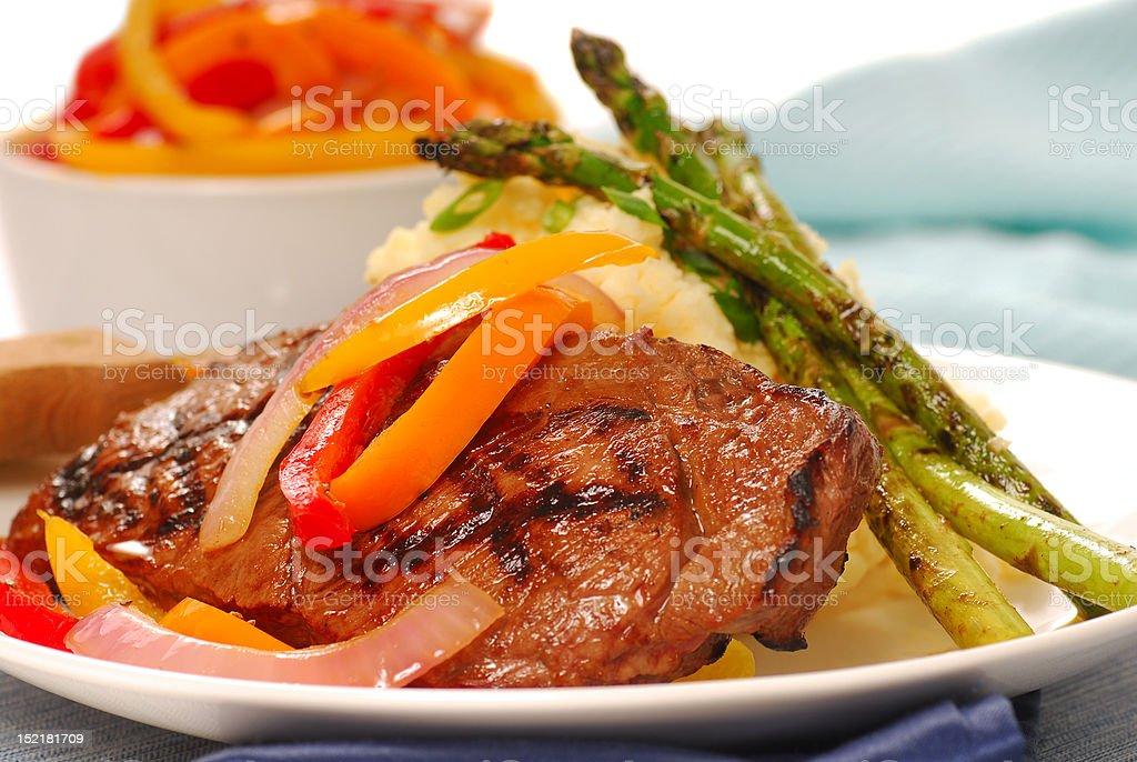 Grilled rib-eye steak with mashed potatoes royalty-free stock photo