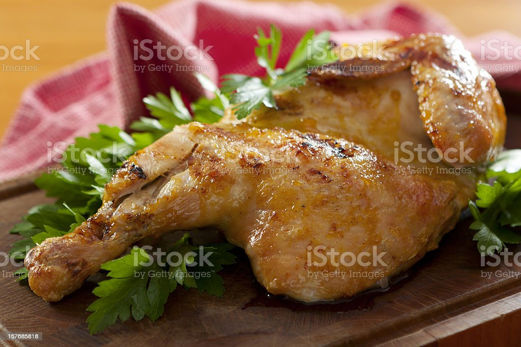 Grilled roasted half chicken with lettuce royalty-free stock photo
