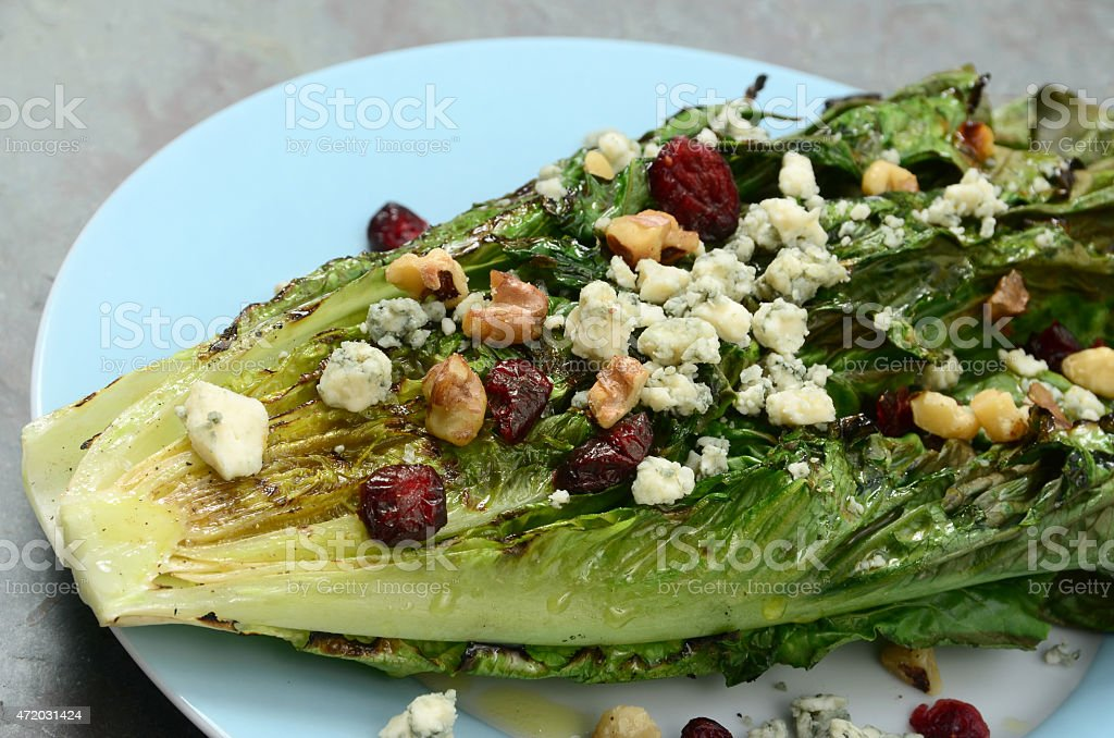 Grilled Romaine Salad with Blue Cheese and Walnuts stock photo