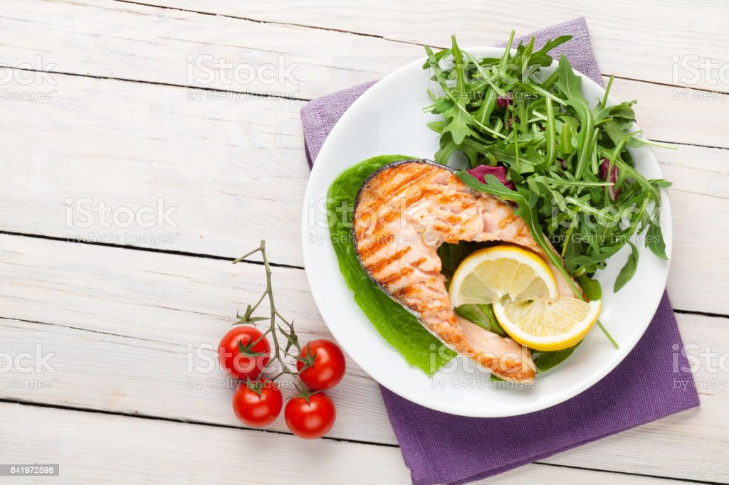 Grilled salmon and salad stock photo