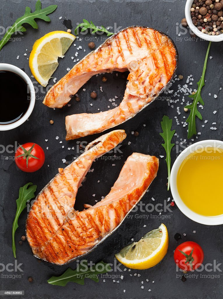 Grilled salmon and spices stock photo