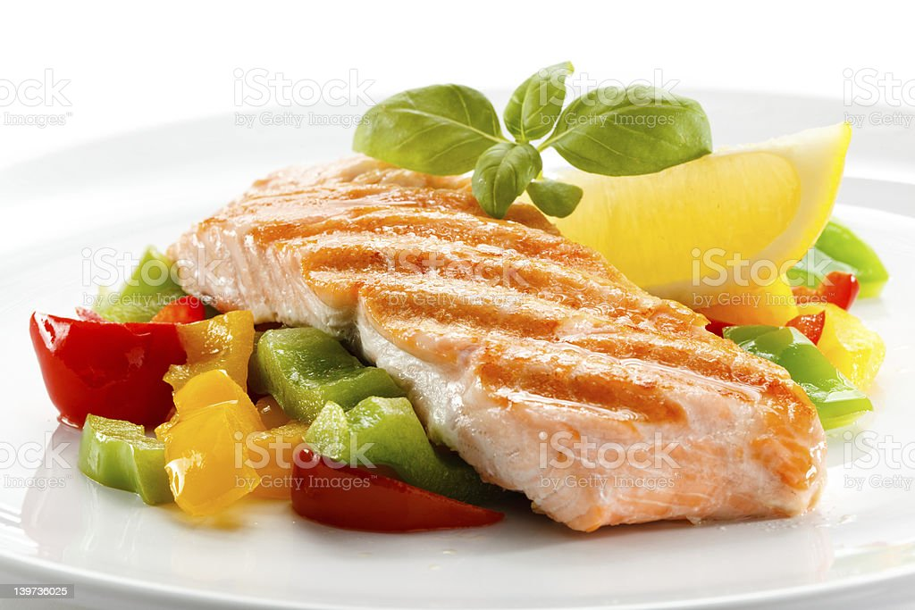 Grilled salmon and vegetables royalty-free stock photo