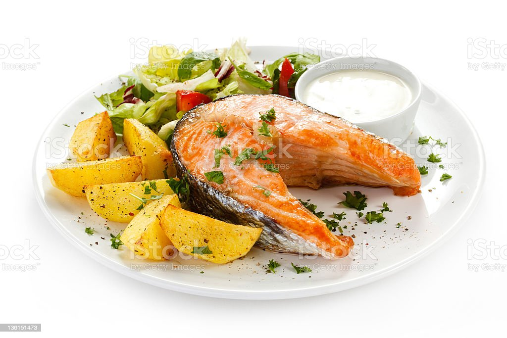 Grilled salmon, baked potatoes and vegetables stock photo