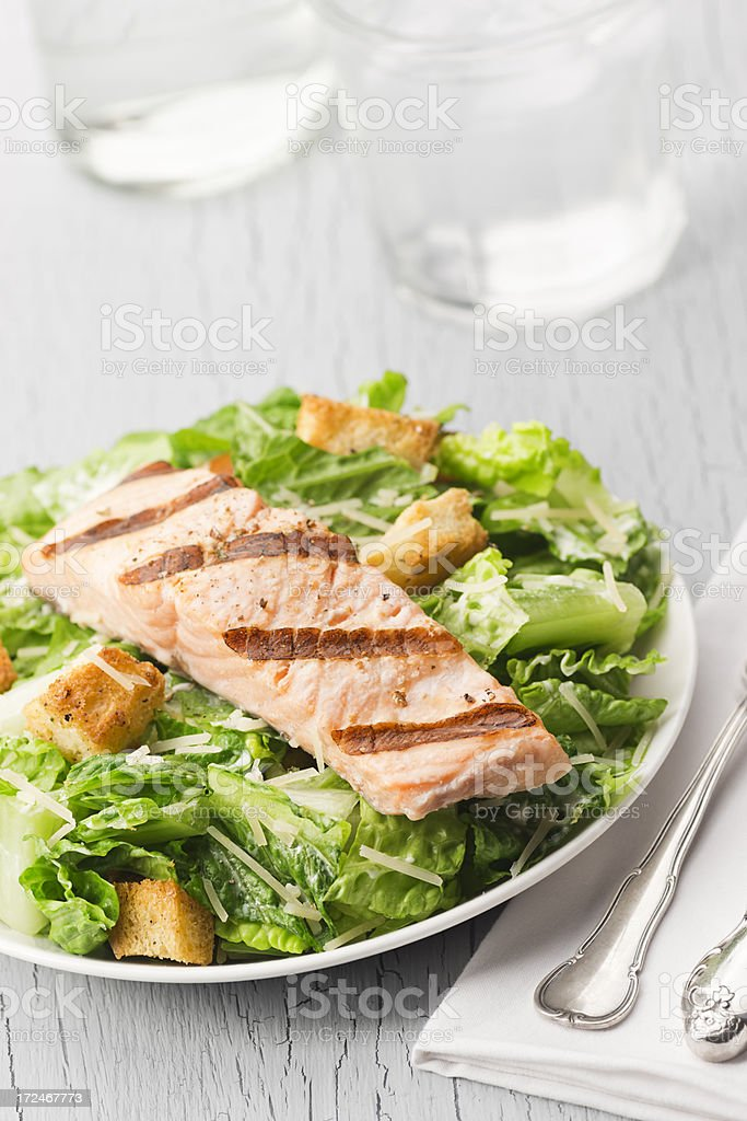 Grilled Salmon Caesar Salad with Drinks stock photo
