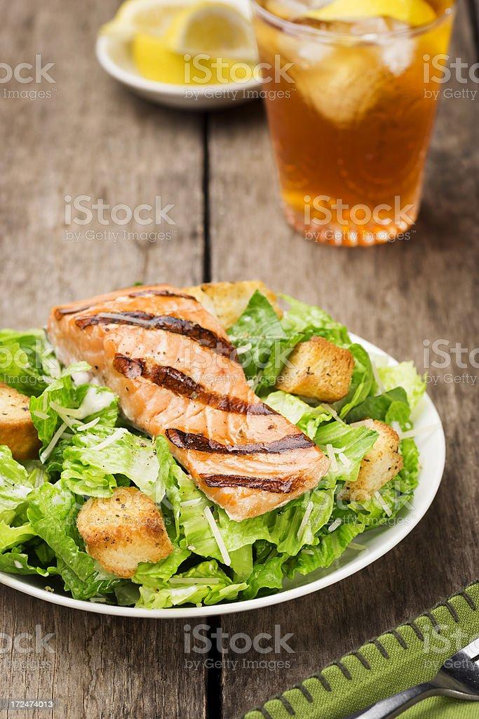 Grilled Salmon Caesar Salad with Iced Tea stock photo