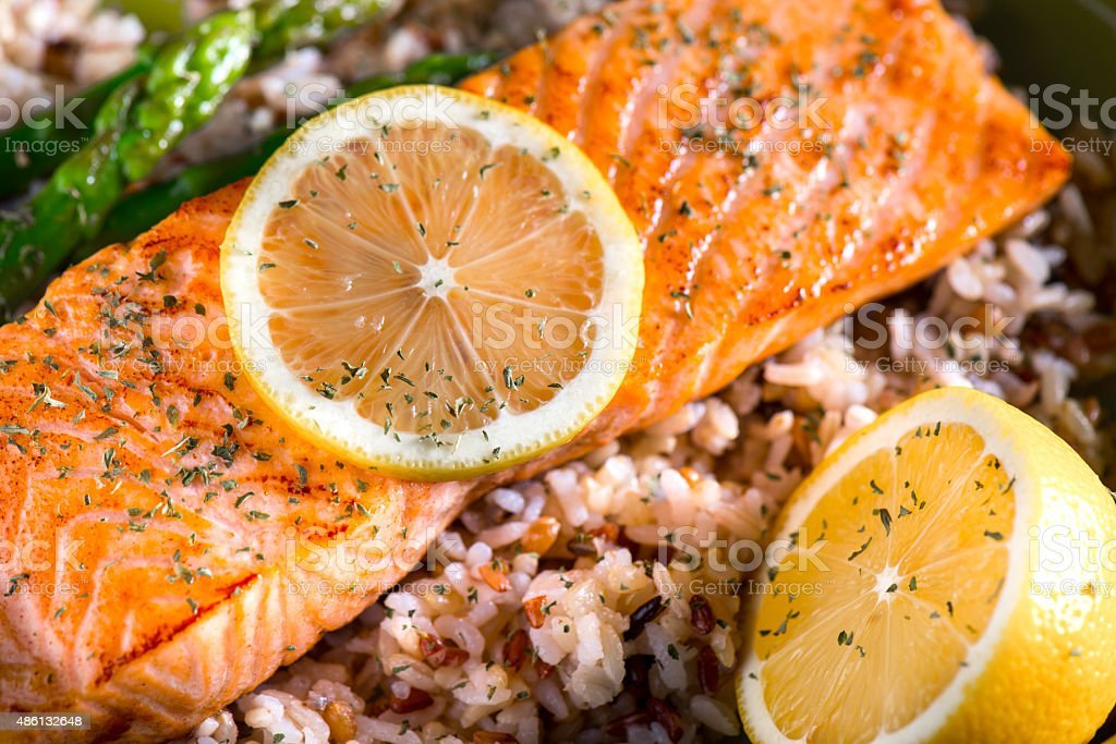 Grilled Salmon Dinner over brown rice and wild rice stock photo