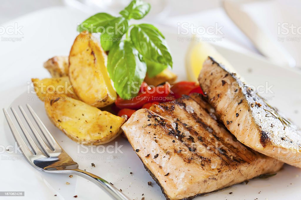 Grilled salmon filet with baked potatoes royalty-free stock photo