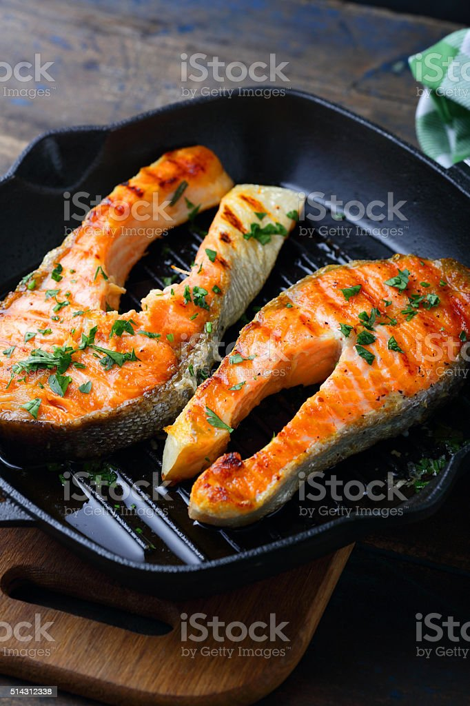 Grilled Salmon on a grill pan stock photo