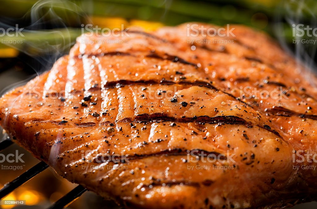 Grilled salmon on grill stock photo