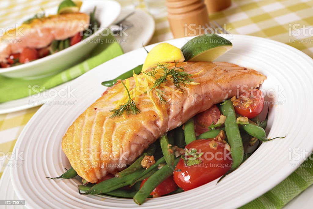 Grilled salmon on top of the salad royalty-free stock photo