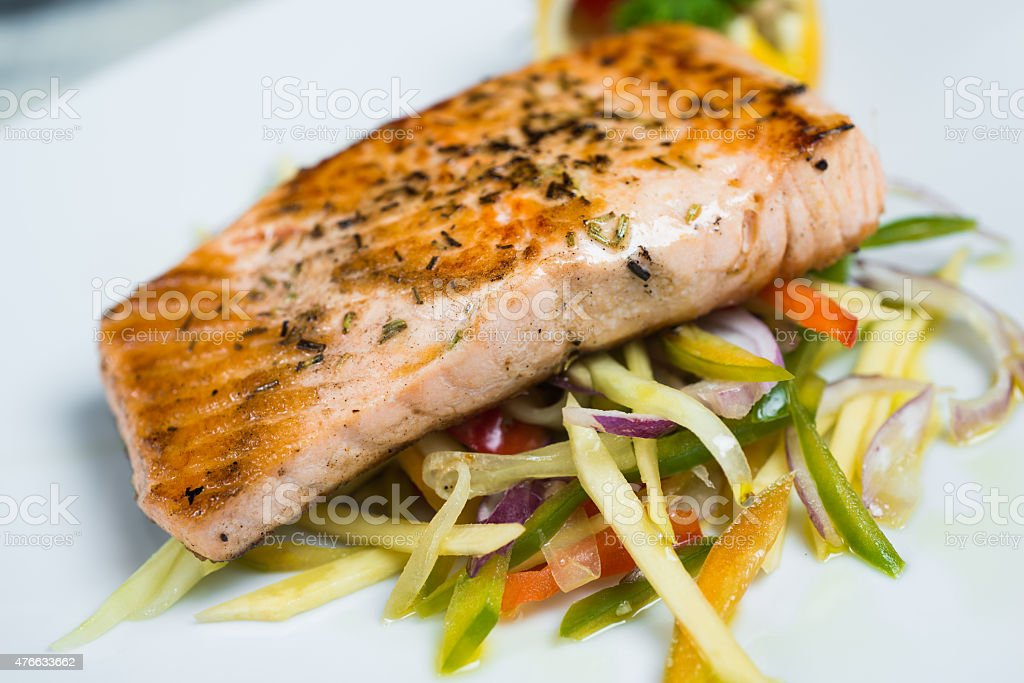 Grilled salmon steak and vegetables stock photo