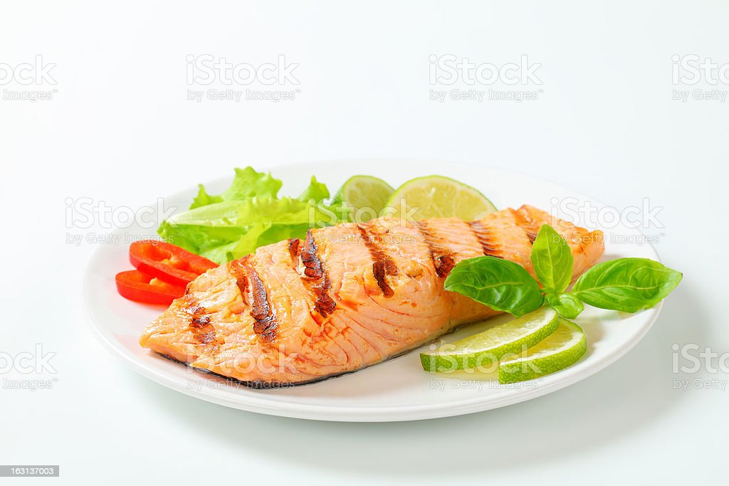 Grilled salmon steak on a plate stock photo