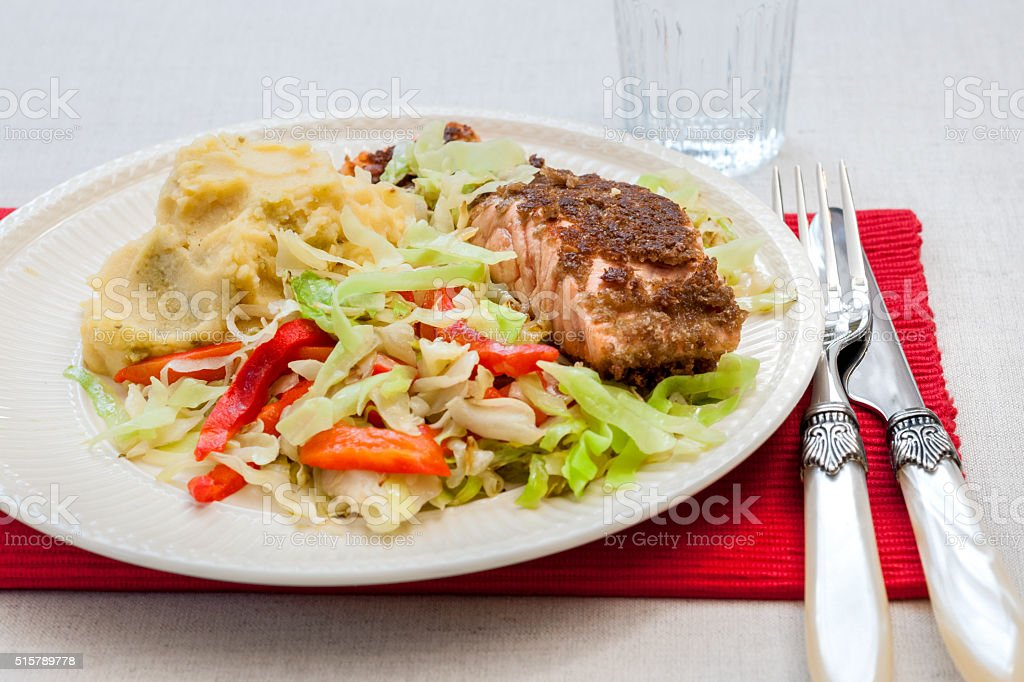 grilled salmon steak on ribbon pasta and stir-fried vegetables stock photo
