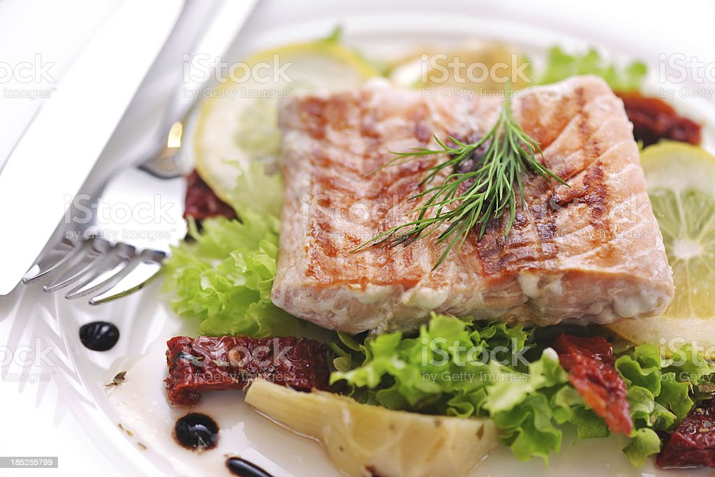 Grilled Salmon steak with antipasto salad royalty-free stock photo