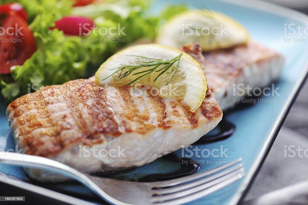 Grilled Salmon steak with fresh salad and balsamic vinegar sauce royalty-free stock photo