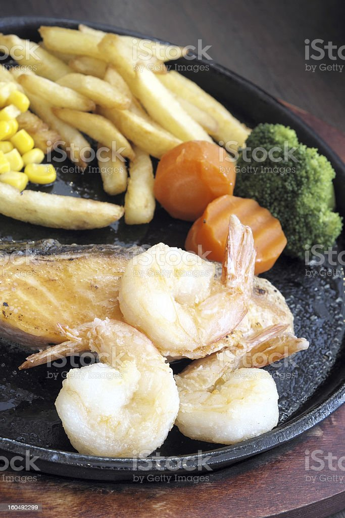 Grilled salmon steak with shrimp. royalty-free stock photo