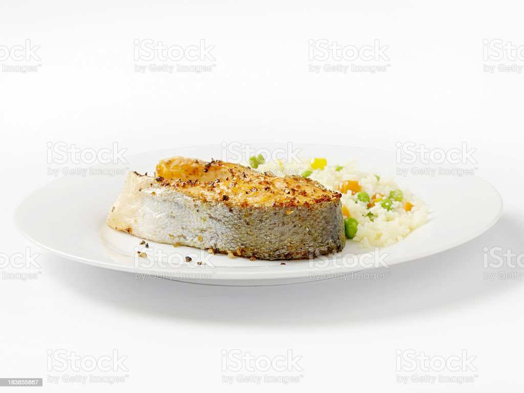 Grilled Salmon Steak with Vegetable Couscous royalty-free stock photo