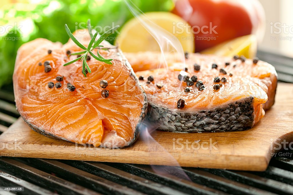 Grilled salmon steaks and fresh vegetables stock photo