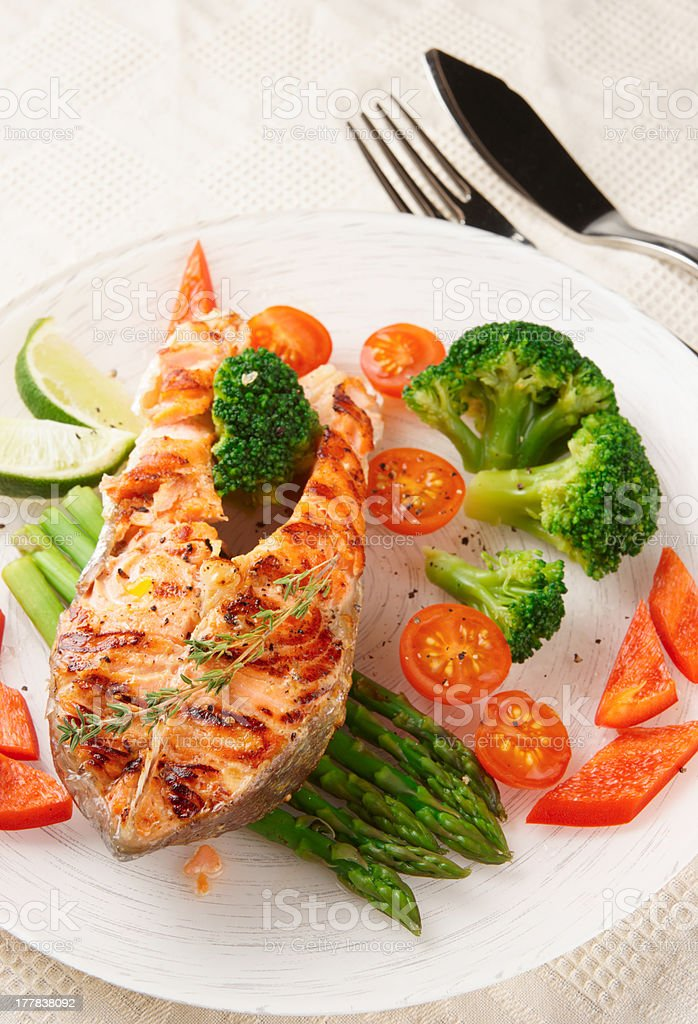 Grilled salmon steaks in plate on table royalty-free stock photo
