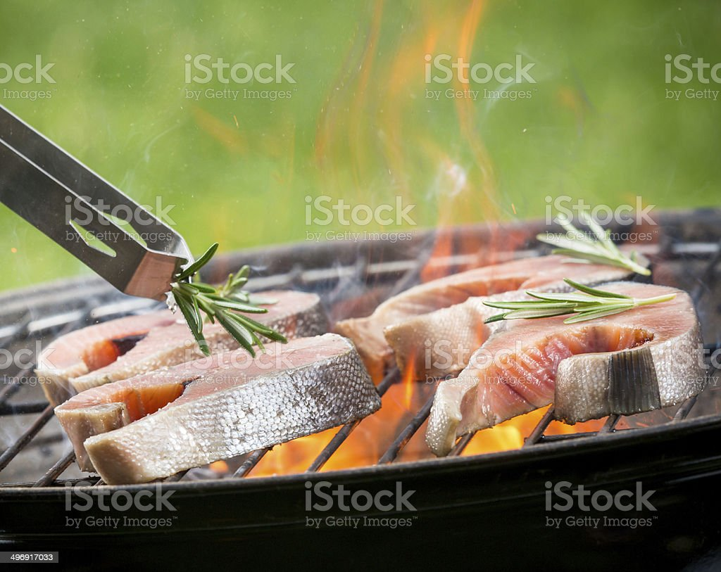 Grilled salmon steaks on fire stock photo