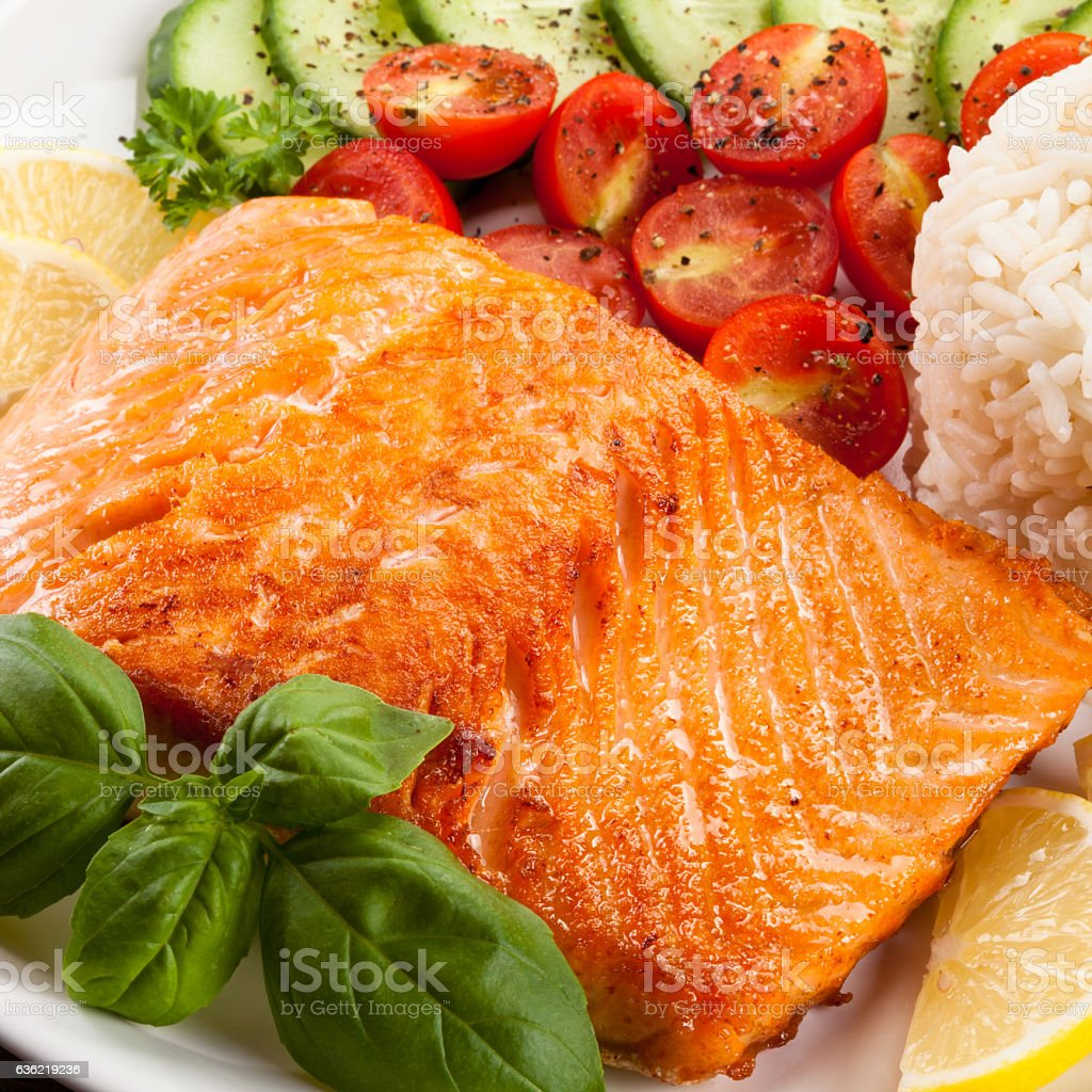 Grilled salmon, white rice and vegetables stock photo