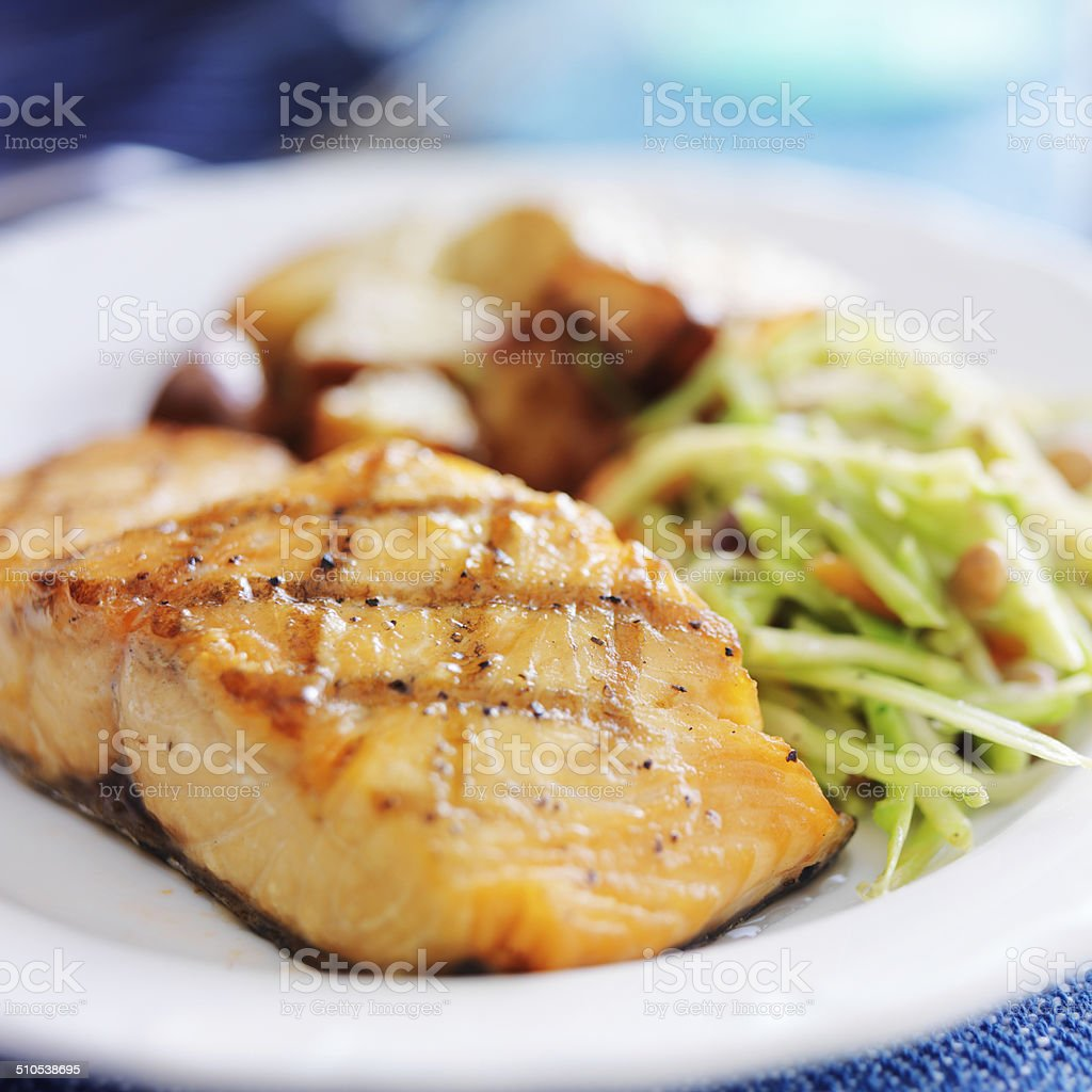 grilled salmon with asian slaw and roasted potatoes stock photo
