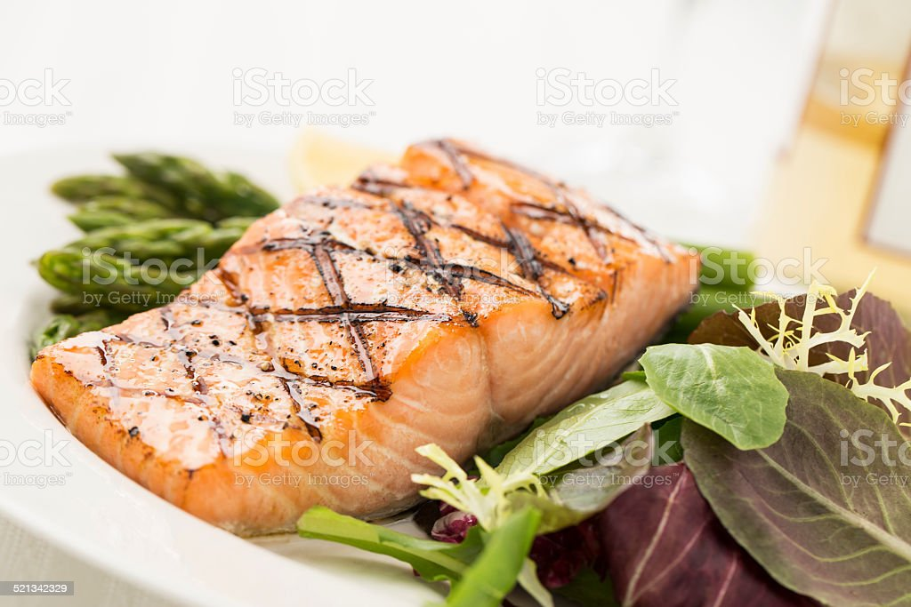 Grilled Salmon with Asparagus and Salad stock photo
