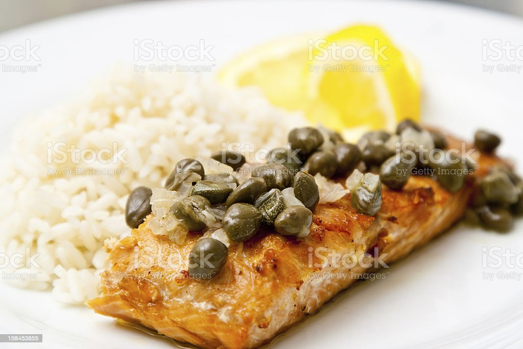 Grilled salmon with caper sauce stock photo