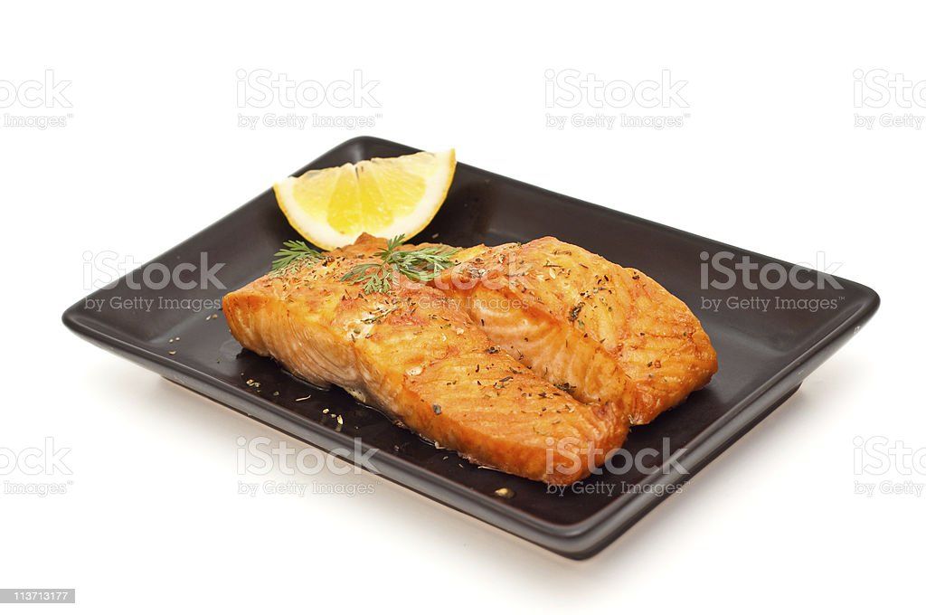 Grilled salmon with lemon isolated on white royalty-free stock photo