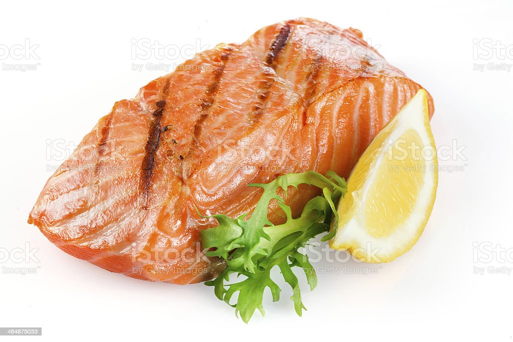 Grilled salmon with lemon isolated on white stock photo