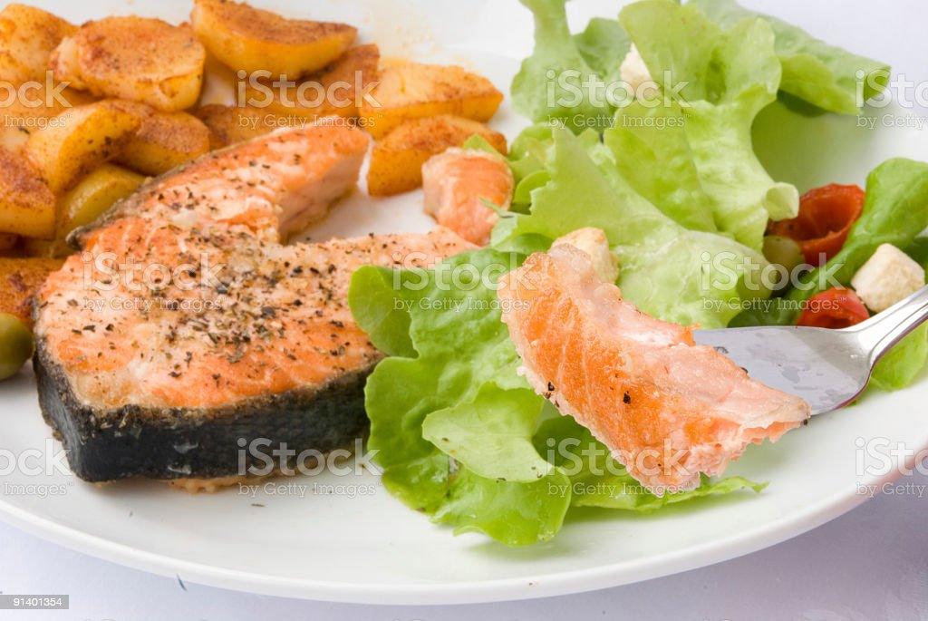 Grilled Salmon with Lettuce Salad, Potato ,Croutons  2 royalty-free stock photo