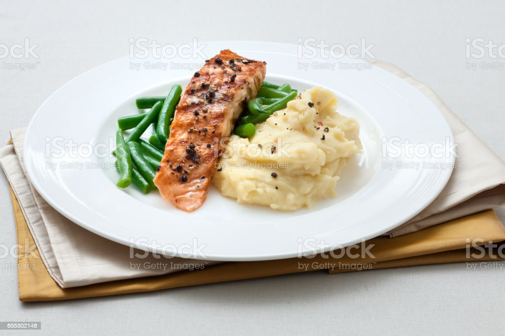 Grilled salmon with mashed potatoes and green beans stock photo