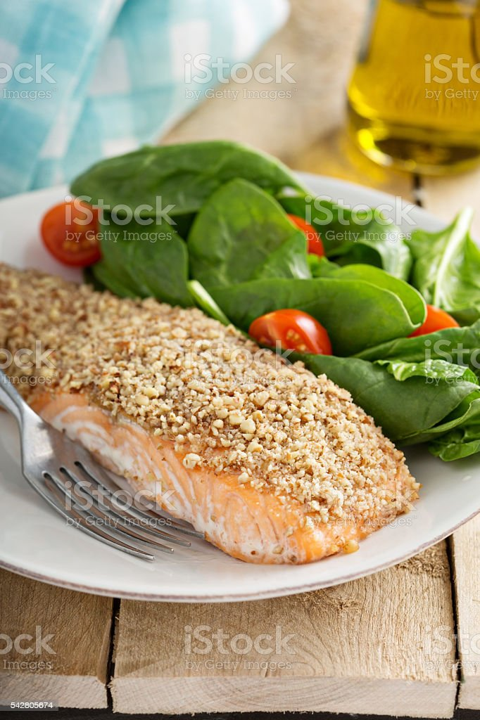 Grilled salmon with nut crust stock photo