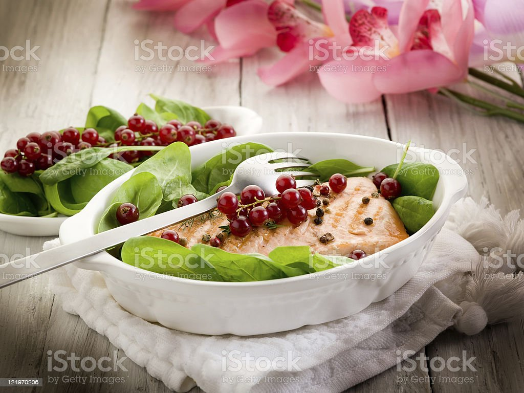 grilled salmon with redcurrant and fresh spinach salad royalty-free stock photo