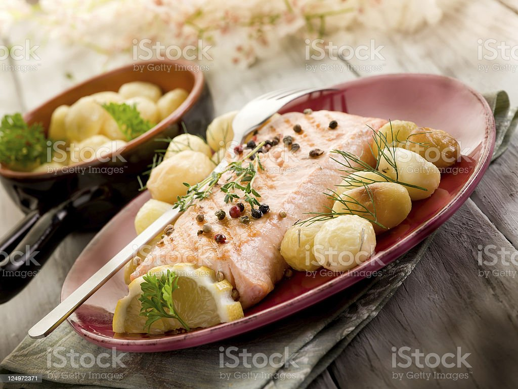 grilled salmon with roasted potatoes royalty-free stock photo