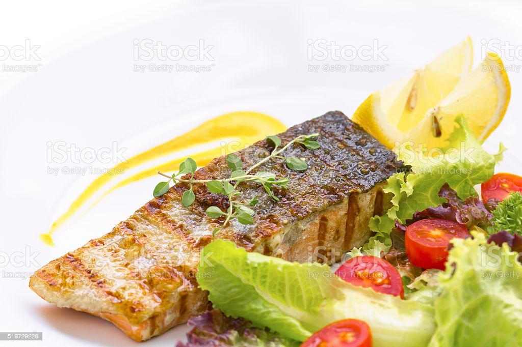 Grilled Salmon With Salad On White stock photo