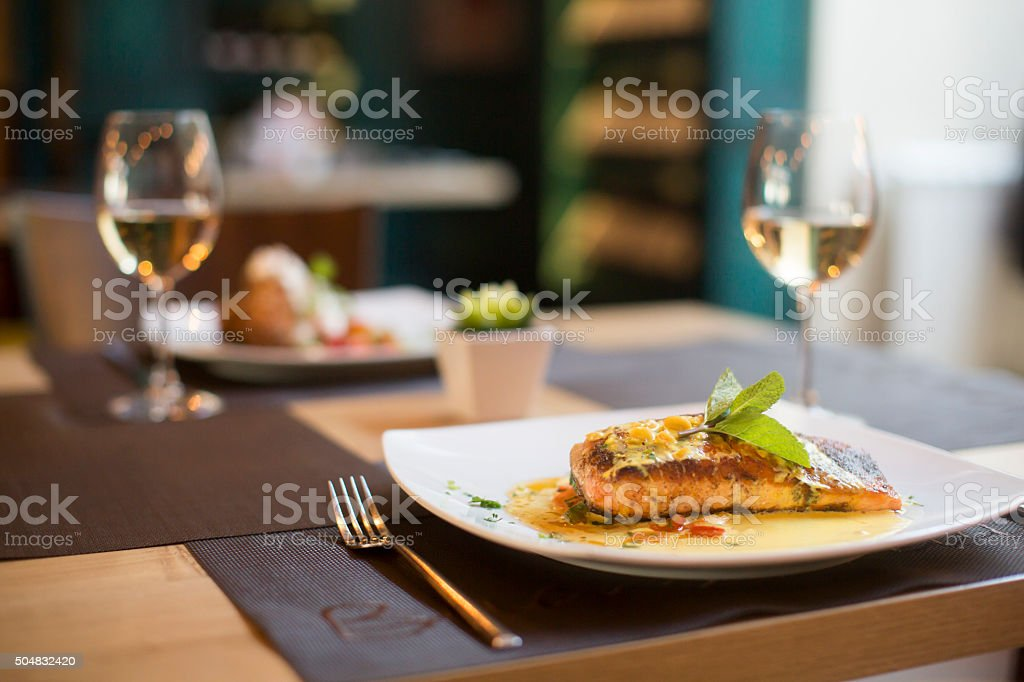 Grilled salmon with sauce and herbs stock photo