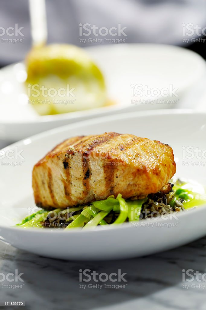 Grilled salmon with sauteed vegetables royalty-free stock photo