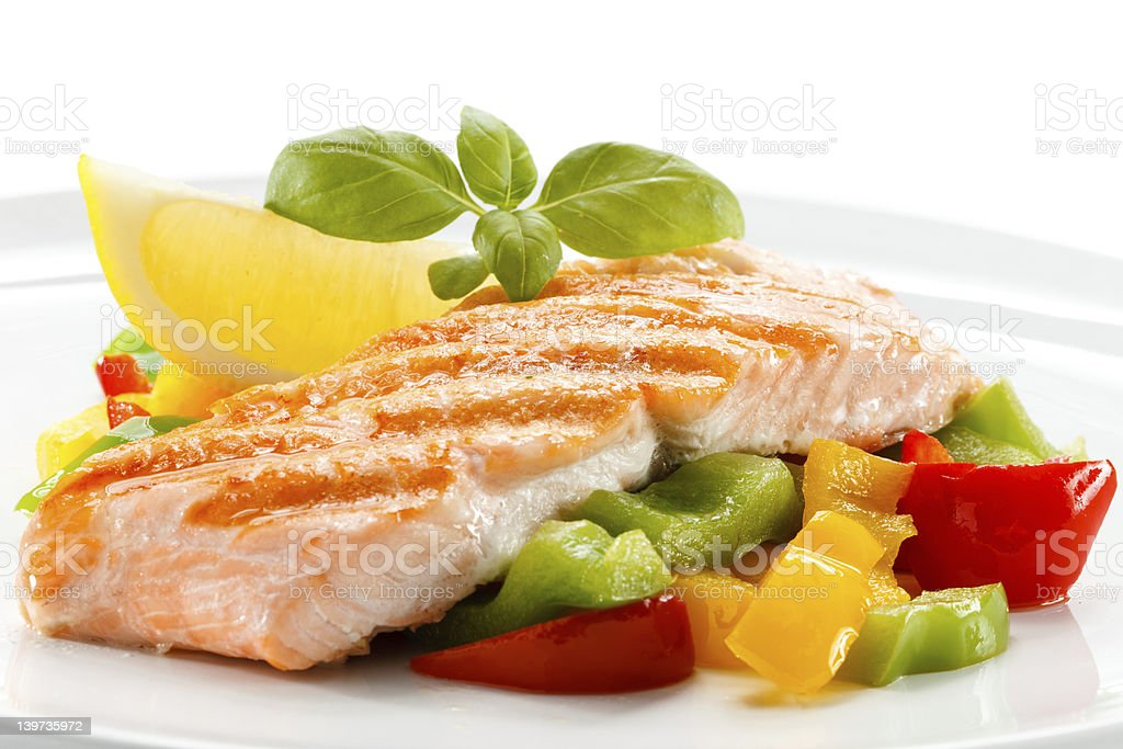 Grilled salmon with vegetables and lemon slice royalty-free stock photo