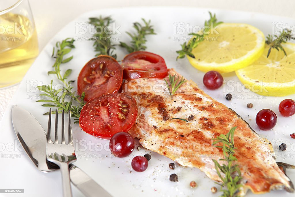 Grilled Salmon withe lemon and spices royalty-free stock photo