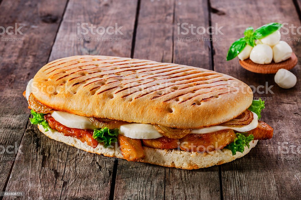 grilled sandwich with chicken and mozzarella cheese stock photo