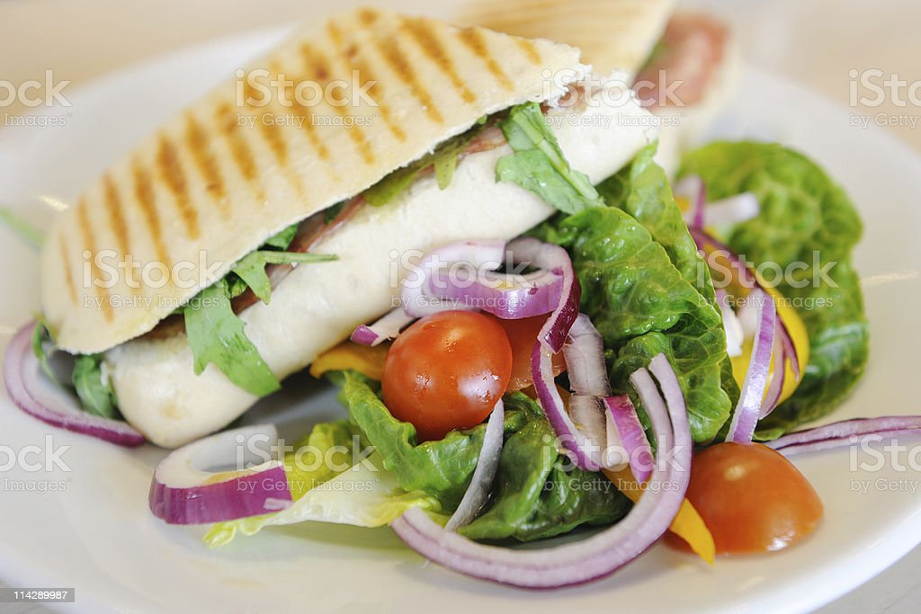 Grilled Sandwich (Panini) with Salad stock photo
