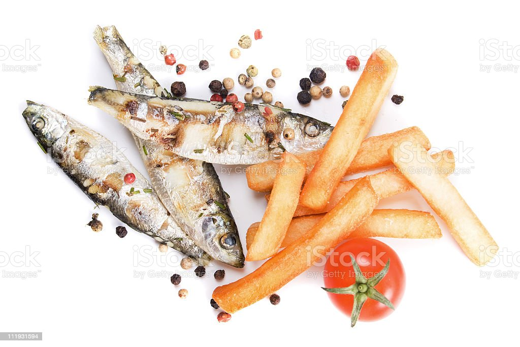 Grilled sardine fish and french fries stock photo