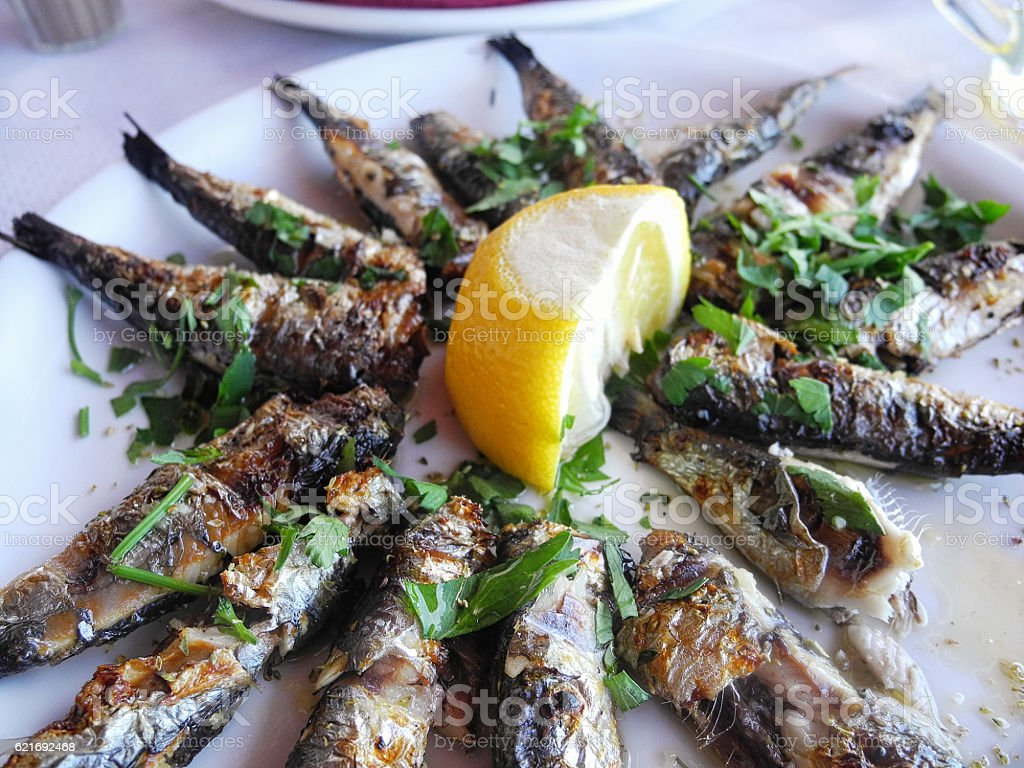 Grilled sardines on a plate stock photo