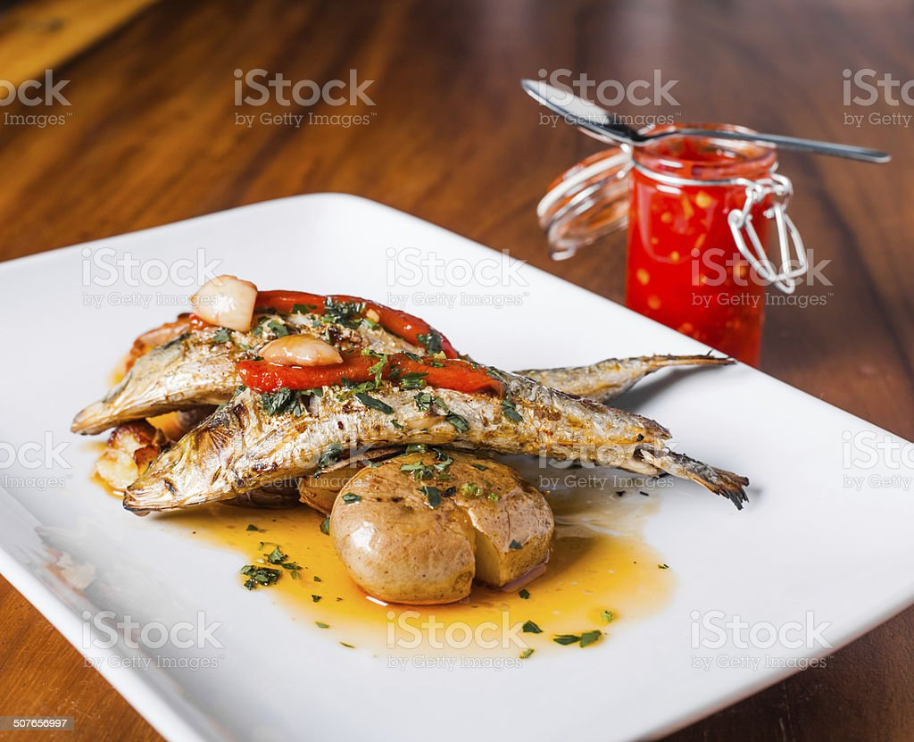 Grilled Sardines Plate with Red Pepper and Potato stock photo