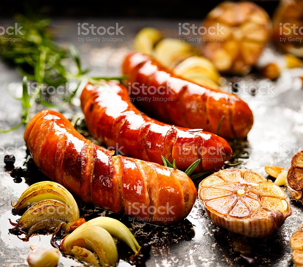 Grilled sausage with garlic and onions stock photo