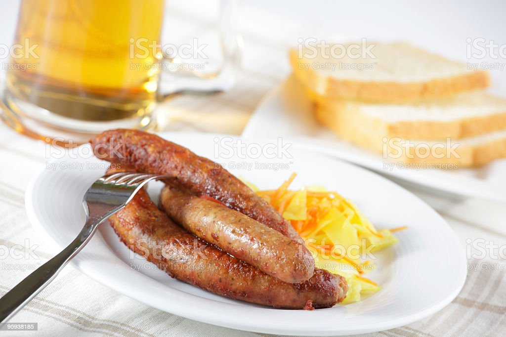 Grilled sausage with sauerkraut royalty-free stock photo
