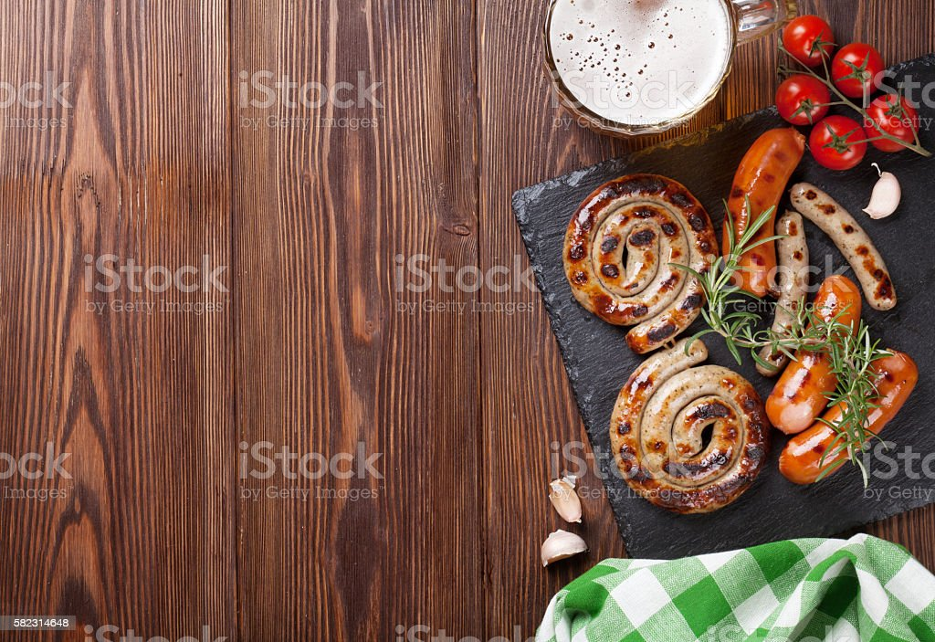 Grilled sausages and beer mug stock photo