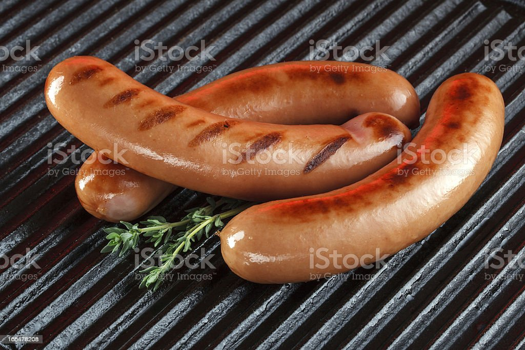 Grilled sausages on the barbecue royalty-free stock photo
