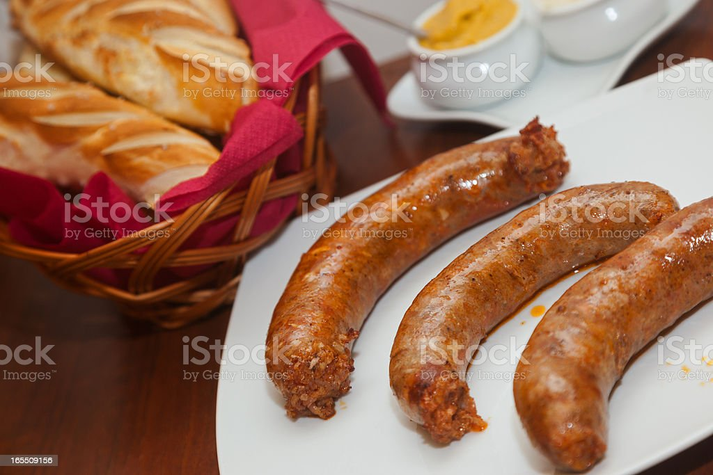 Grilled Sausages on the plate royalty-free stock photo